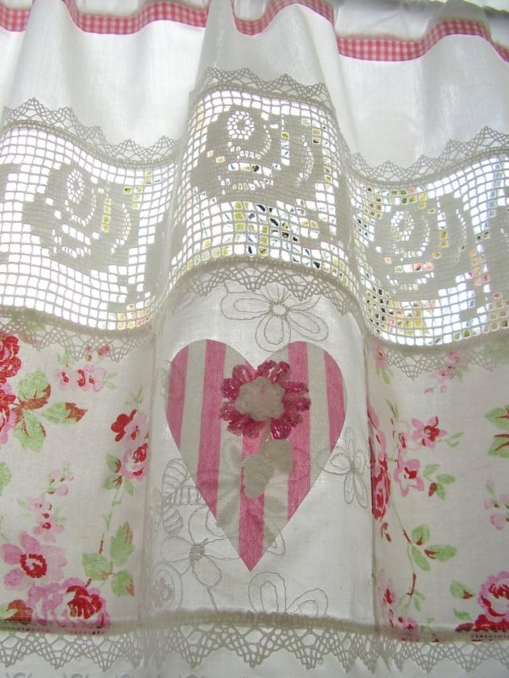 Shabby chic curtains with soft pink flowers.