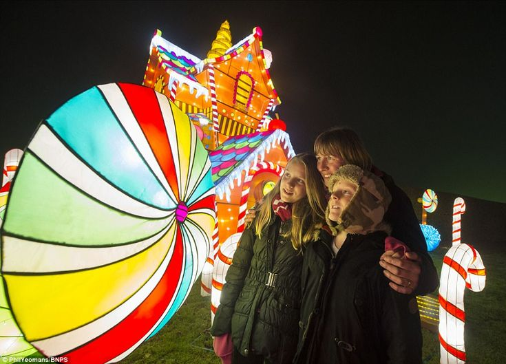 A family is pictured mesmerised by a festive light display at Longleat, which sits next to the village of Horningsham and towns of Warminster, Westbury and Frome in Wiltshire and Somerset