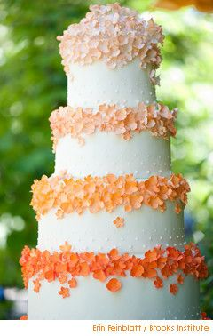 Orange ombre flowers on four-tier cake. Not these flowers but still a cute idea
