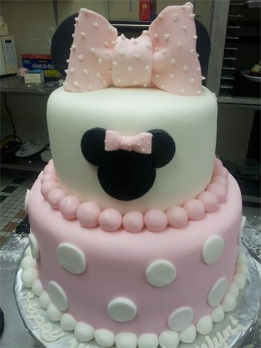 pink Minnie Mouse baby shower cake. Kinda think to keep it classic go with red.