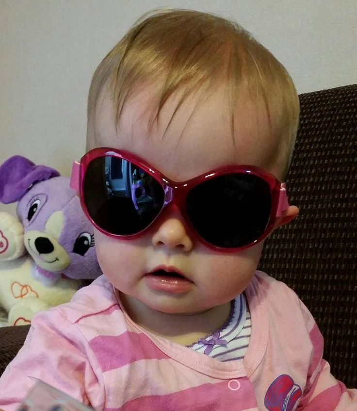 Cute as a button in Retro Banz sunglasses in 'Berry Pink'; $38.