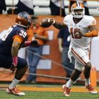 Clemson quarterback Tajh Boyd (10) looks to pass under pressure from Syracuse linebacker Cameron Lynch (38) during the first half of an NCAA college football game on Saturday, Oct. 5, 2013, in Syracuse, N.Y. (AP Photo/Mike Groll)