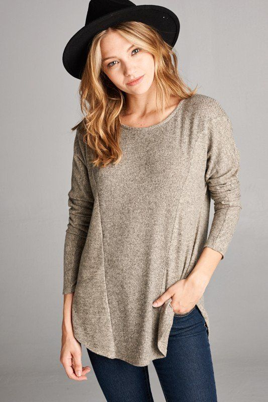 Loose fit, round neck, long sleeve ribbed top. Model is wearing a small Made in the USA 74% rayon, 21% polyester, 5% spandex