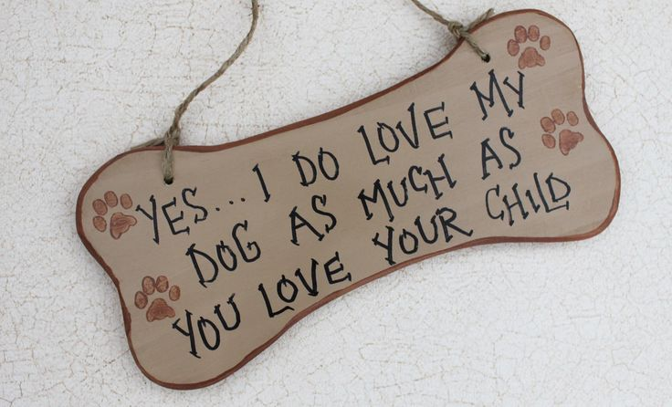 Sign I Love My Dog As Much As You Love Your Child. $15.00, via Etsy.
