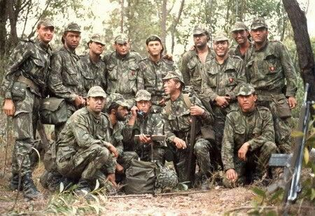 """Portuguese Soldiers during the African Colonial conflict (61-74) wearing m64 vertical lizard """"Angolan"""" pattern camo uniforms with m64 webbing kit and G3 rifles."""