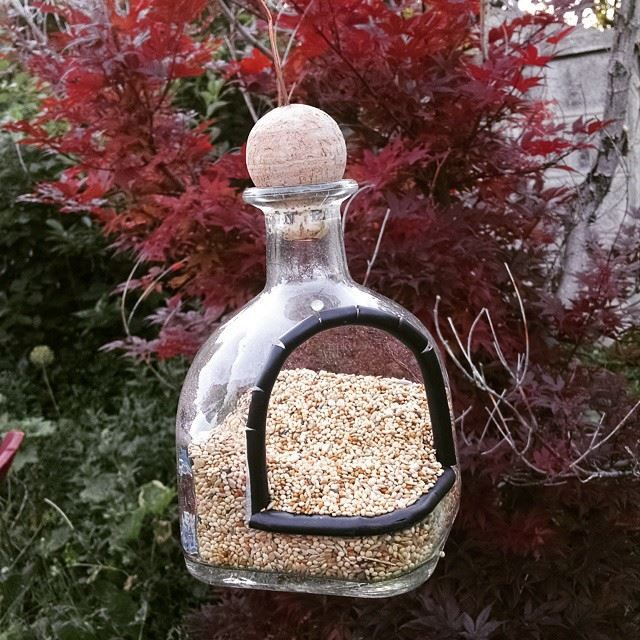 Tutorial for how to make a bird feeder from a recycled Patron Tequila bottle.