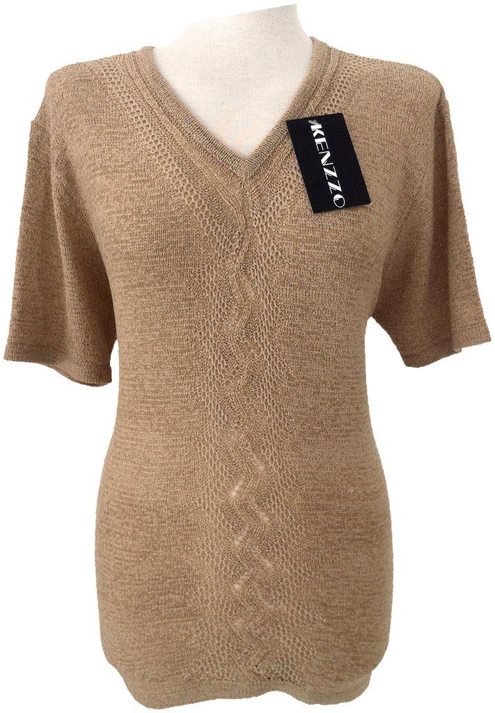 Suéter de perlé cuello pico, aperturas laterales y cenefa en el medio. Tallas M/L, XXL