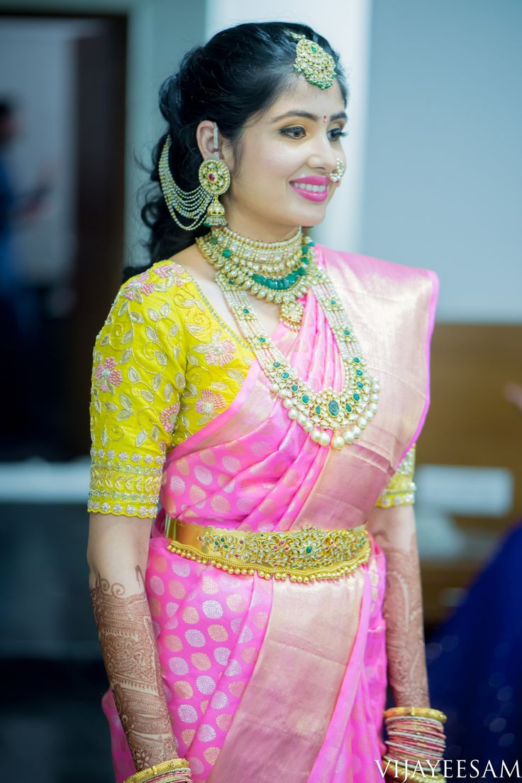 South Indian bride. Diamond pearl Indian bridal jewelry.Temple jewelry. Jhumkis.Pink silk kanchipuram sari with contrast yellow blouse.braid with fresh jasmine flowers. Tamil bride. Telugu bride. Kannada bride. Hindu bride. Malayalee bride.Kerala bride.South Indian wedding.