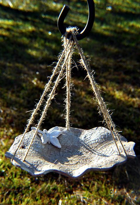Hang this under the bird feeder to catch the seed and serve as a second tier bird feeder