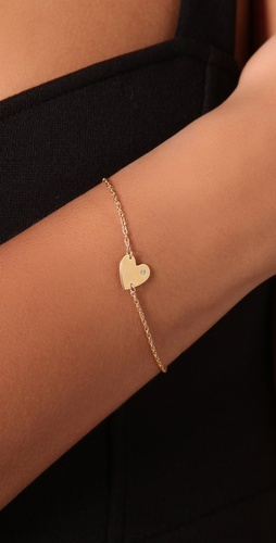 gold heart bracelet. want this.