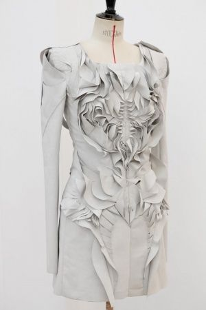 Grey dress detail with artful fabric manipulation creating skeletal patterns, texture & symmetry // Yiqing Yin