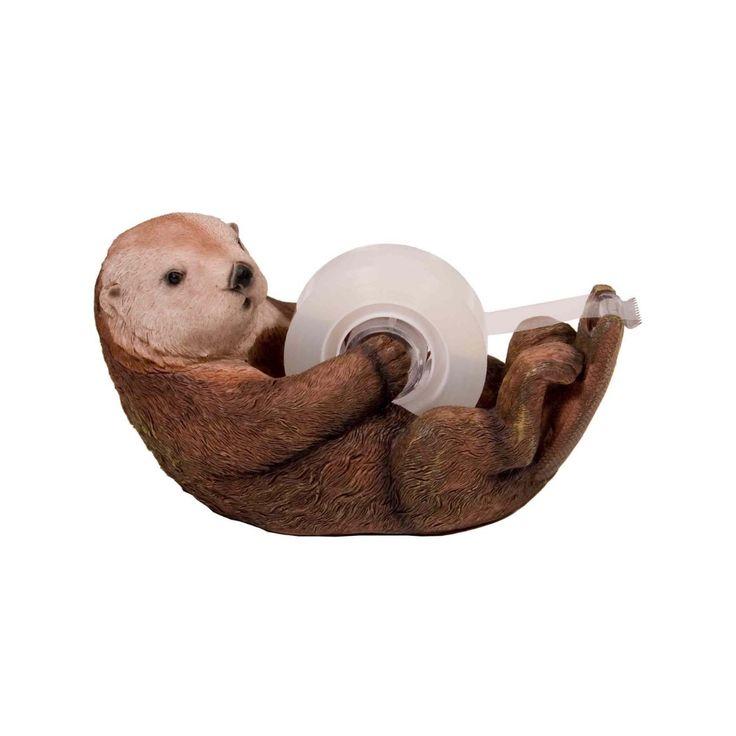 C'est OTTO la loutre! Cette créature vous aidera joyeusement dans l'accomplissement de vos tâches. Elle prendra plaisir à tenir votre ruban adhésif au bureau comme à la maison!