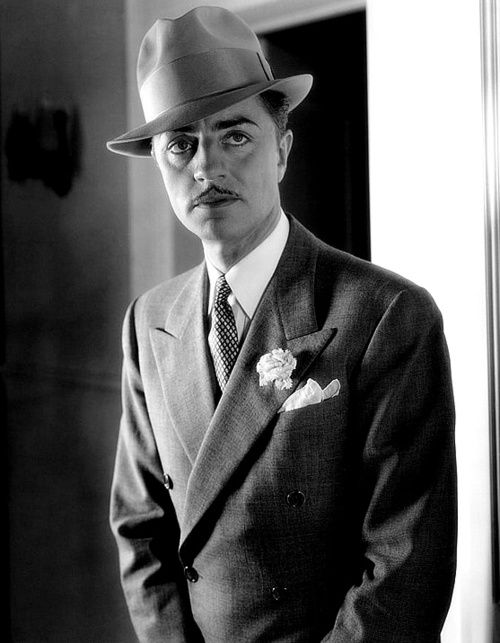 Actor William powell -- see the width and angle of the peaked suite lapel and the height of that fedora, fedora's had less height in 40s.