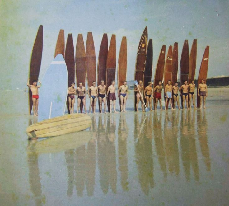 Line up of Jersey boards mainly paddle boards but with a modern malibu and strange wide SUP /paddle board in the foreground. Photo by John Houiellebecq. Photos taken from 'Surfing Secrets' about Jersey's surf history.