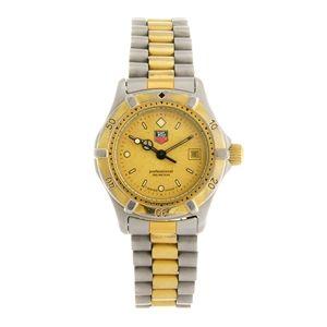 A bi-colour quartz lady's Tag Heuer Series 2000 bracelet watch.