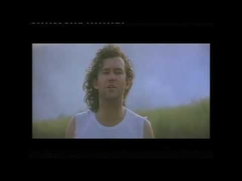 Jimmy Barnes (Australian)  - Working Class Man - He believes in God and Elvis! Set against the sugar cane fields in Northern Queensland where the cane is burnt at harvesting time.
