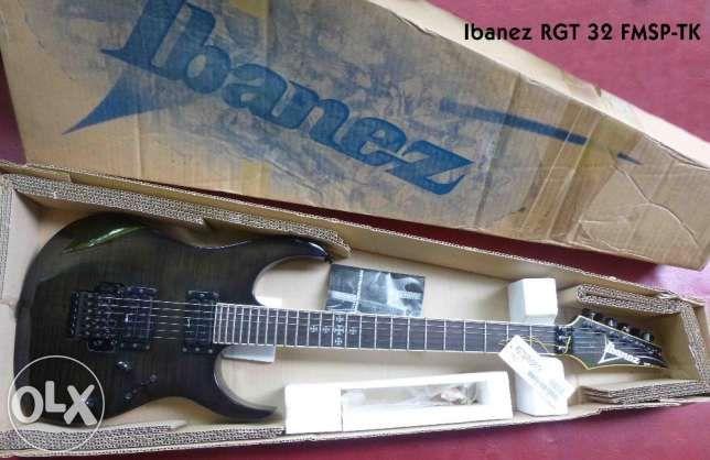 Gitar listrik ibanez gio GRX70, warna hitam, made in china, Pickup masih bawaan, tremolo semi up dow...
