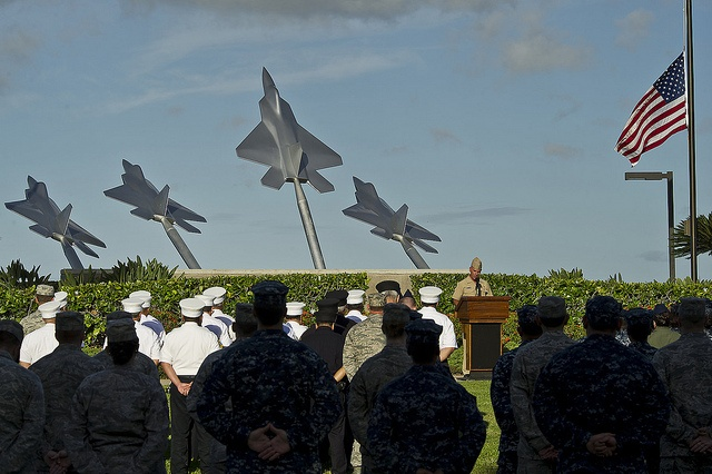 "U.S. Navy Capt. Jeffery James, Joint Base Pear Harbor-Hickam (JBPHH), commander gives remarks to service members and civilian first responders near the ""Missing Man Memorial"" at JBPHH, Hawaii during a Patriots Day ceremony to commemorate the 11th anniversary of the 9/11 terrorist attacks at the World Trade Center, Pentagon, and Flight 93. Sept. 11, 2012.  (Department of Defense photo by U.S. Air Force Tech. Sgt. Michael R. Holzworth/Released)"