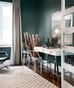 I like the combination of the dramatic gray-green color with taupe/natural elements.  Could work well in dining room or guest room/office.