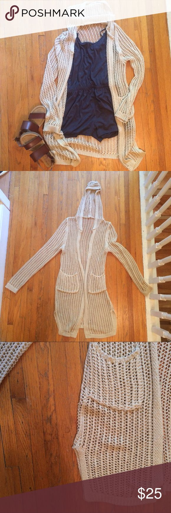 Long Open Knit Cardigan with Hood and Pockets NEVER WORN long cardigan with a hood and pockets. Model pics are only uploaded to show the fit/style - the color is not accurate. Color is actually a beige/tan. Super cute for the summer! Pair with a summer dress or romper and some cute sandals or wedges :) purchased from Apricot Lane Boutique in Madison, WI.                       **BLUE H&M ROMPER ALSO FOR SALE ($8) - see separate listing or bundle** POL Sweaters Cardigans