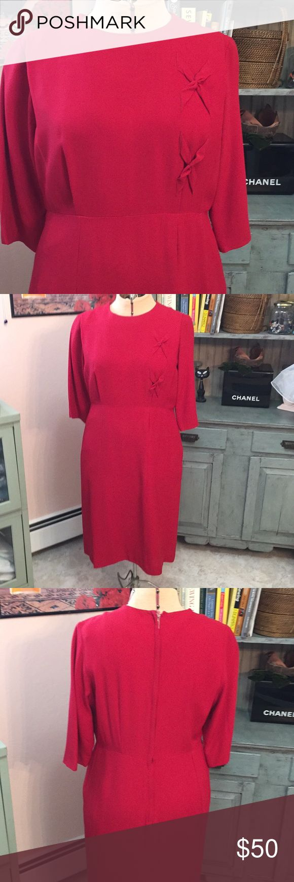 Vintage Leslie Fay sheath dress Beautiful vintage red sheath dress with knot detail down side of chest. Few holes that can be fixed, one under right arm, in front pleat and one on skirt side. All in photos. Length is 40 inches, waist is 17 across and chest is 20. And color is darker in person Vintage Dresses Midi