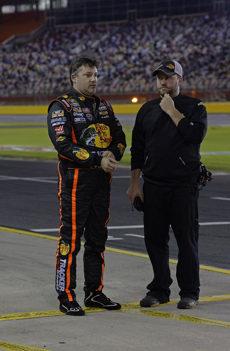 PHOTOS: Tony Stewart chats with crew chief Chad Johnston befor the Bank of America 500 at Charlotte Motor Speedway. View more photos from Charlotte here: http://www.stewarthaasracing.com/media/gallery/index.php