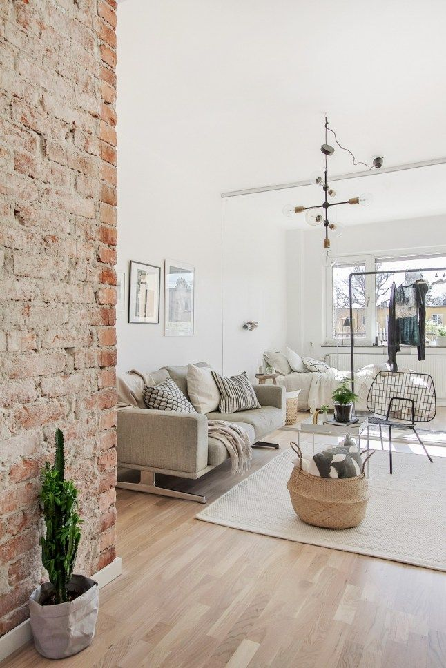 Brick wall in living room.