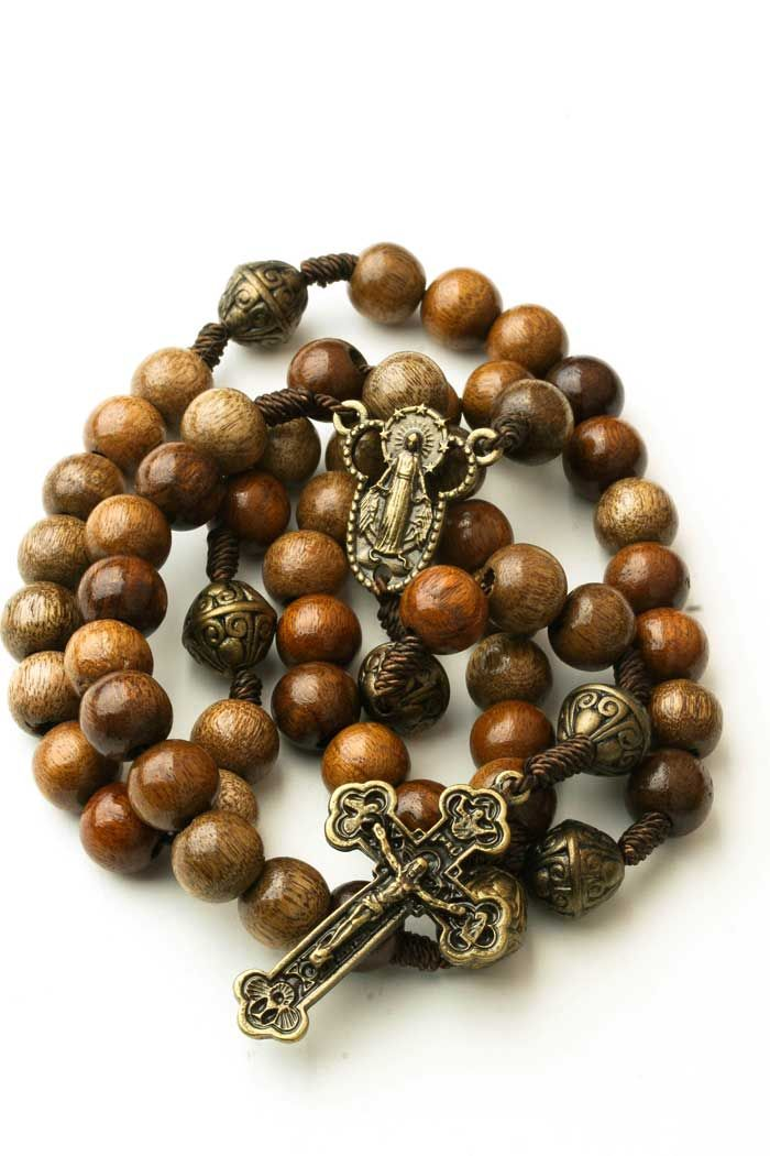 "Wooden Rosary Beads Miraculous Medal For Men & Women :: Men Rosaries :: Rosary Beads. Made in Brazil this rosary features 8mm wood beads with metal Pater beads. Length approx 18"". Free Shipping & Returns"