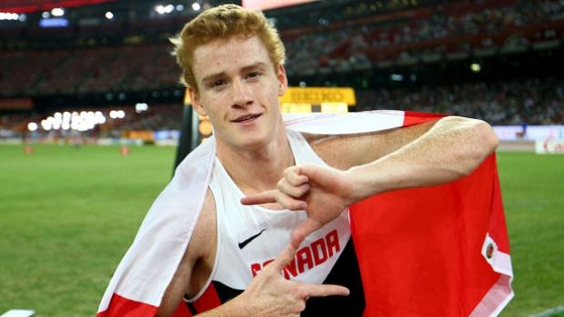 Shawnacy Barber, seen here celebrating his world championship gold medal in August 2015, was selected for three major awards by Athletics Canada, track and field's governing body in Canada.