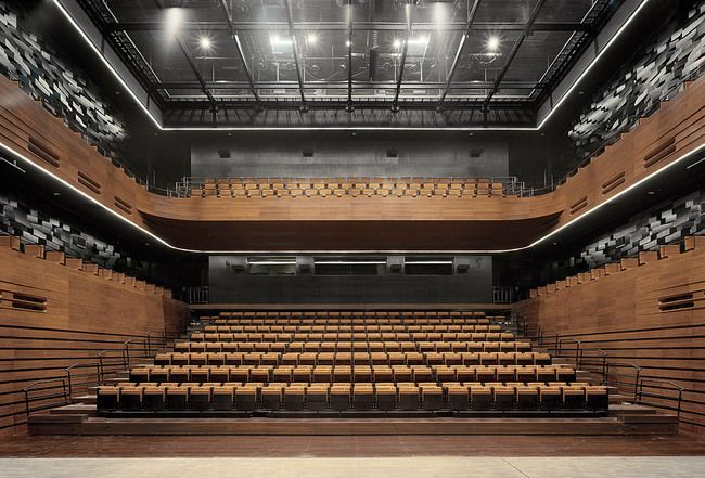 The small auditorium as seen from stage. The 700 seats are partly retractable to enable a multi-functional use of the space.
