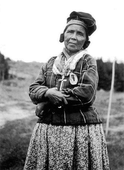 Innu woman in traditional dress. The traditional dress is seldom seen in today's age. - Name, date, location & photographer unidentified.