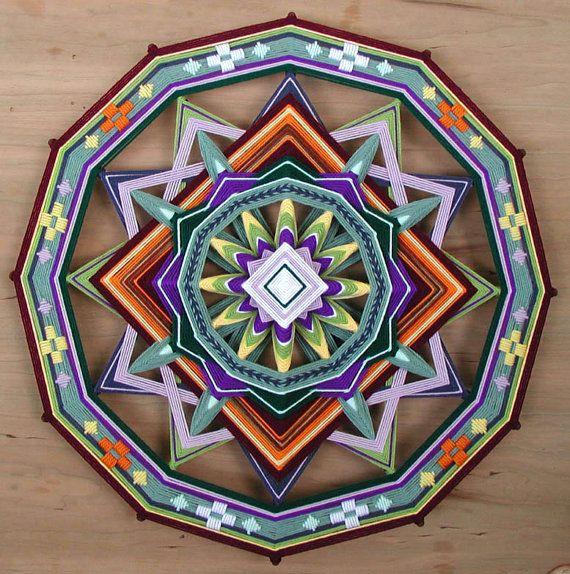 Shield of Love, a 24 inch, wool yarn, Ojo de Dios, by Jay Mohler