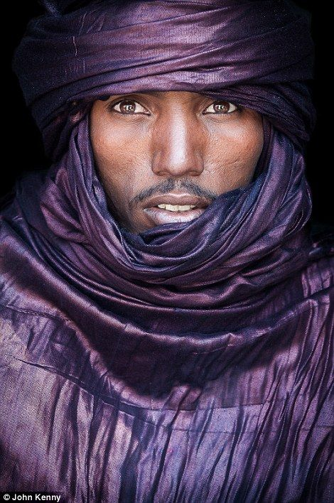This man is from the Tuareg people in Mali. They are primarily nomads from the Saharan int...