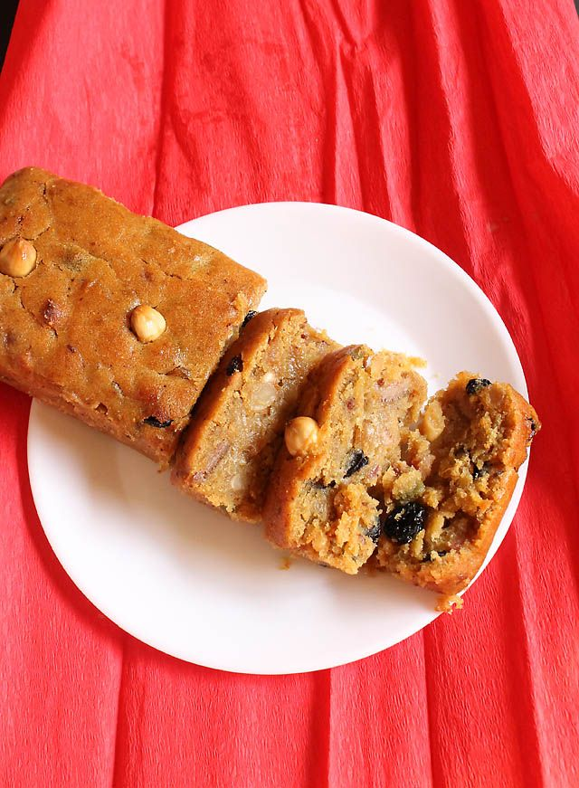 Eggless Christmas Fruit Cake, Eggless Christmas Fruit Cake Recipe, Easy Eggless Christmas Fruit Cake:Finally I am posting an Instant Eggless Christmas Fruit Cake that too a vegan fruit cake ! I was getting a lot of request from my readers so made an Eggless Christmas Fruit Cake. I did make many kind of cakes for Christmas and Eggless Christmas Fruit Cake was one of them. I made Goan Baath Cake, Rum Fruit Cake, Sponge Cake along with other sweets and savories. You could check out this link…