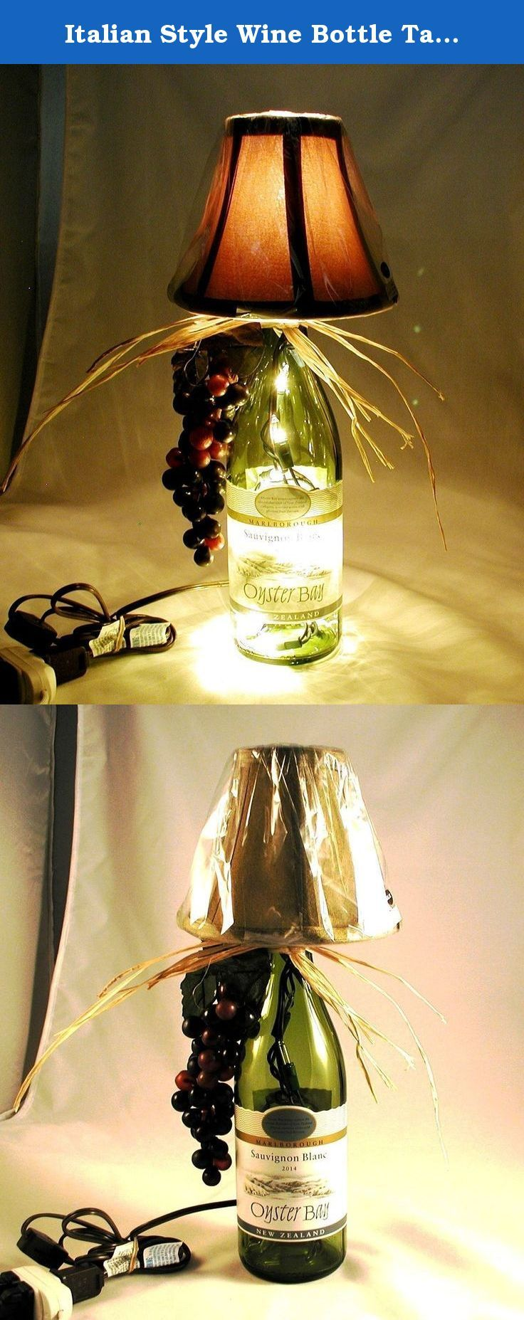 "Italian Style Wine Bottle Table Lamp Crafted From a Recycled Oyster Bay Sauvignon Blanc 2014 Wine Bottle. Comes Exactly as Pictured with a switched cord. Striking lit or unlit. Shipping is included. This very striking wine bottle table lamp has been crafted with a recycled Oyster Bay Sauvignon Blanc 2014 Wine wine bottle. The bottle is light green and the shade is green. Lamp is approximately 15"" tall and approximately 10 "" wide (including the raffia). It has a nite light under the shade…"