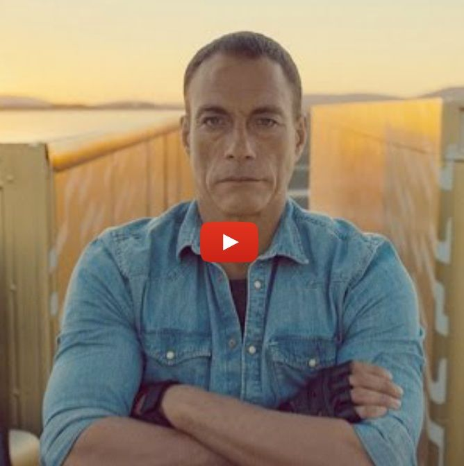 Jean-Claude Van Damme does the splits between two moving semi-trucks while listening to Enya