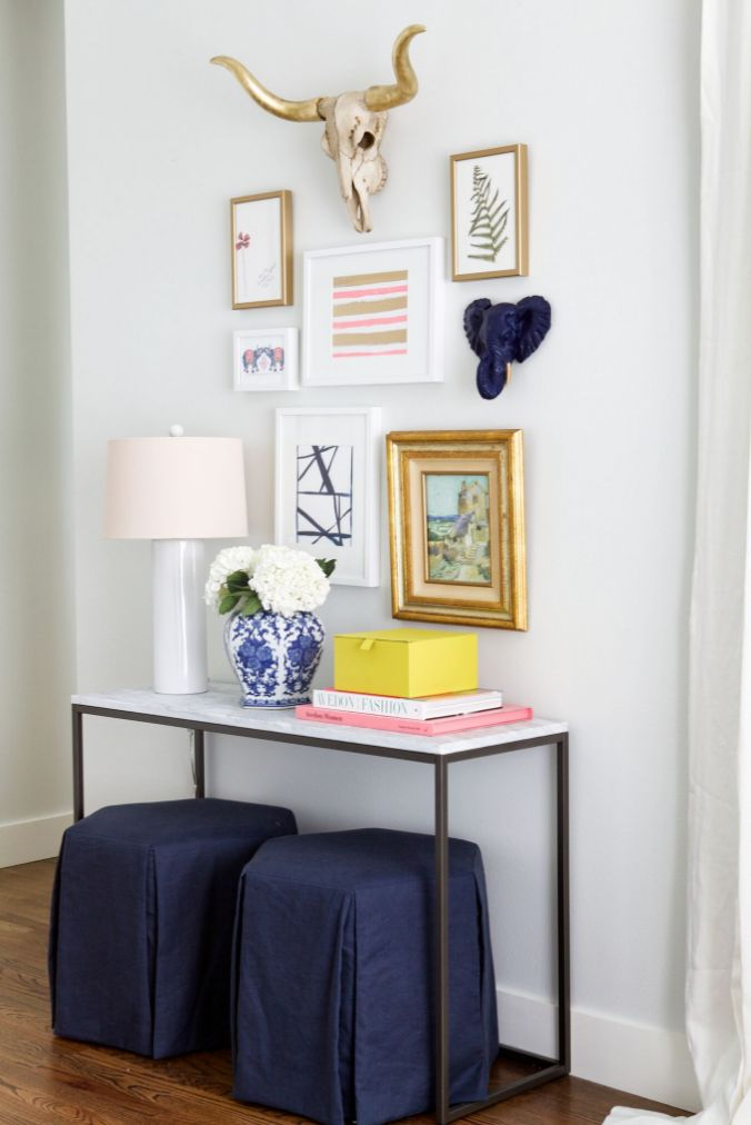 Tuck two ottomans under you entryway table to ensure you always have a place to take off your heels. Top it off with an eclectic gallery wall.   https://katiekime.com/collections/canvas