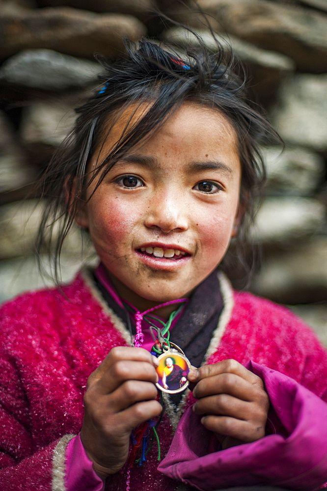 A little Buddhist girl in the Tsum Valley, Manaslu region, Nepal