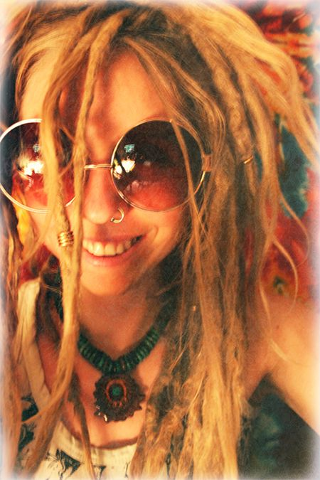 dreads. nose ring. big sun glasses :]