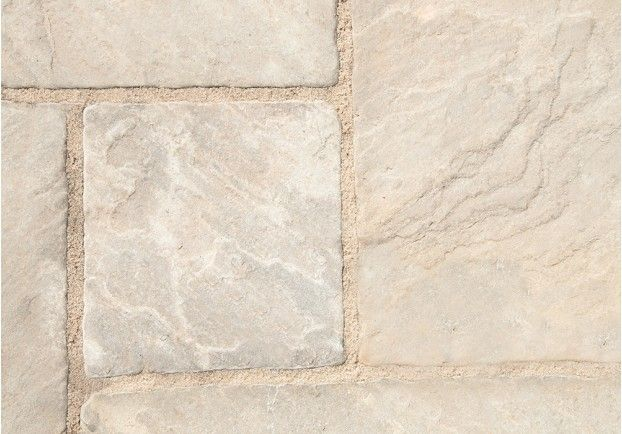 The beautiful Millstone Grey Pavers have been hand split to leave the sandstone with the layers present in the stone. The tiles also have a distressed edge to add a further rustic element.