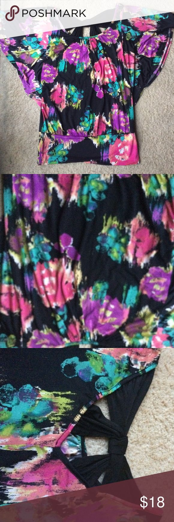 Black flutter sleeve top Black flutter sleeve top with abstract Floral pattern, beautiful vibrant colors. Silky feel, cross cross detail in back, and comes in at hips. Can be dressed up or down! HeartSoul Tops Blouses