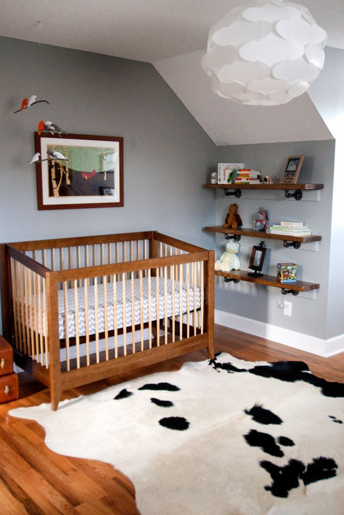 Cowhide Rug in this Natural Explorer Nursery - awesome space!