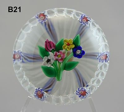 More Photos below . RE-LISTED WITHOUT RESERVE A stunning Paul Ysart flower posy paperweight, consisting of a posy of 5 flowers floating in a basket of latticin o and red,white and blu e twist canes. S