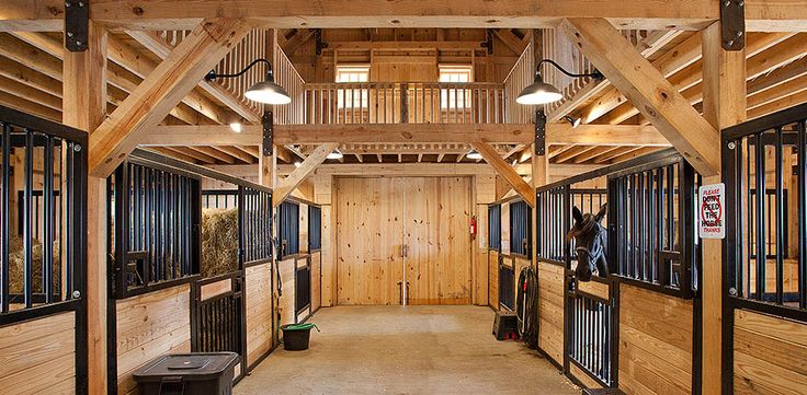 Living quarters above, with a glass panel  open floor above the stalls.. no need to walk downstairs to check on the horses!