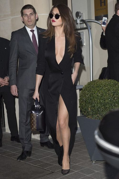 a long tuxedo dress. Selena Gomez in Ronald Van Der Kemp Couture out in Paris on March 8, 2016.