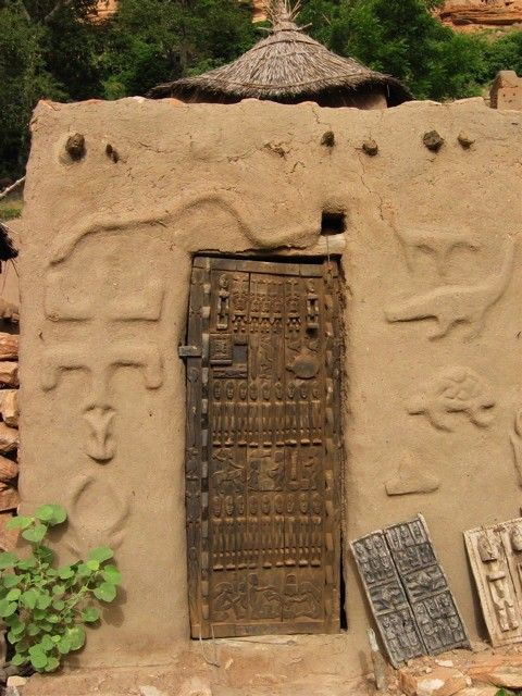 Africa | Entrace with carved wood door.  Dogon country, Mali | ©Sarah J Design & Photography