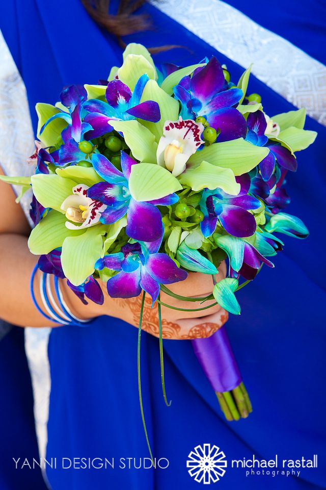 #green cymbodium #orchids and dyed blue, purple dendrobium orchids #bouquet