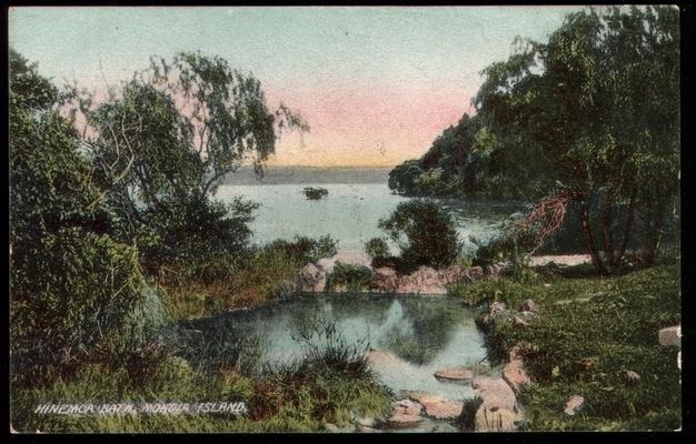 Postcard showing Hinemoa's Bath, the hot pool on Mokoia Island in Lake Rotorua. (undated, from the Waikato University Library collections)