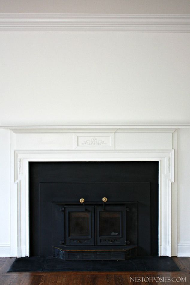 Wood Burning Insert Fireplace AFTER.  Using High Heat Spray Paint to spray the insert and the sides of the fireplace