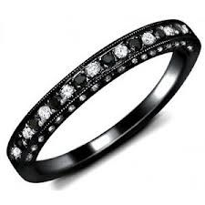 black gold ring with black and white diamonds = Very cool.